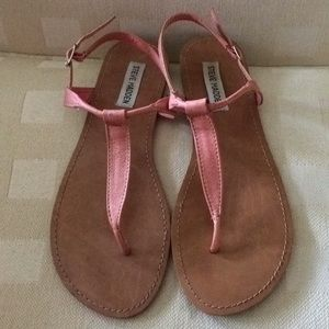 Peach leather sandals.